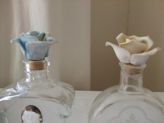 Elegant pair of vintage French perfume bottles with 'biscuit' porcelain rose flower lids.  Paris apartment, cottage chic.