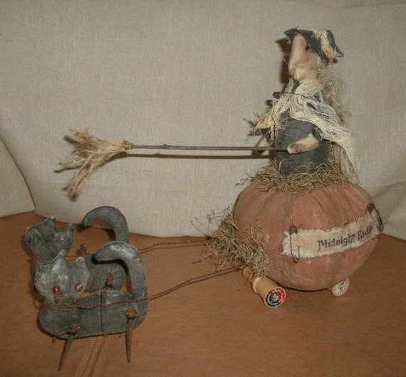 Aged Witch on Pumpkin Carriage