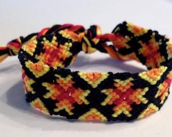 Red, Orange & Yellow Snowflake/Star on Black - Friendship Bracelet