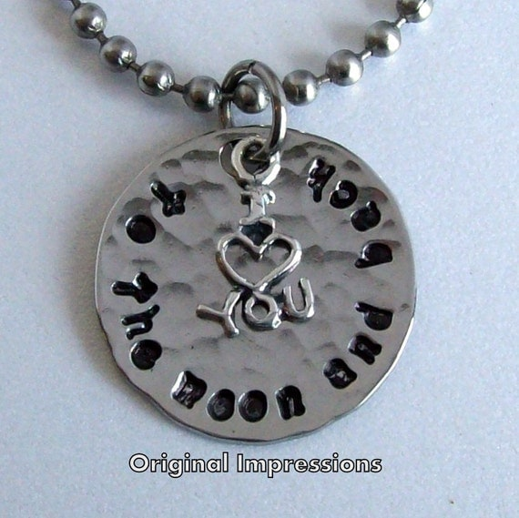 I love you to the moon and back - pendant necklace of hammered stainless steel with a sterling silver charm on a stainless steel bead chain.
