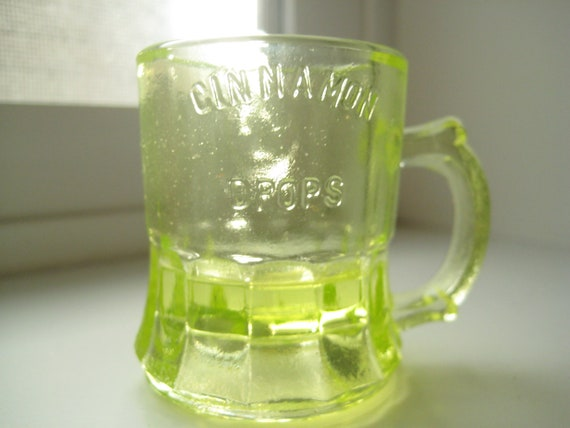 RARE...Vaseline Glass Collector...One Cent Yellow Vaseline Glass Cinnamon Drops Mini Mug Shot Glass....Lowest Price in Market