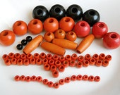 74 Orange , Black , and Red Wooden Beads