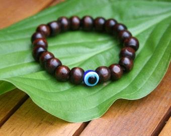 Yogi inspired wood bead bracelet with evil eye bead