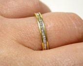 Estate 0.60ct ETERNITY  BAGUETTE Diamond wedding band In Channel Set, ring in 18k yellow gold