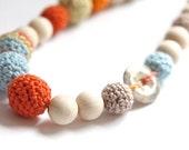 Colors of the autumn statement necklace. Nursing crochet necklace with natural stone. Pastel blue, orange, beige, vanilla