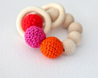 Teething toy with crochet red, pink and orange wooden beads and 2 wooden rings. Wooden rattle. Gift for baby girl.