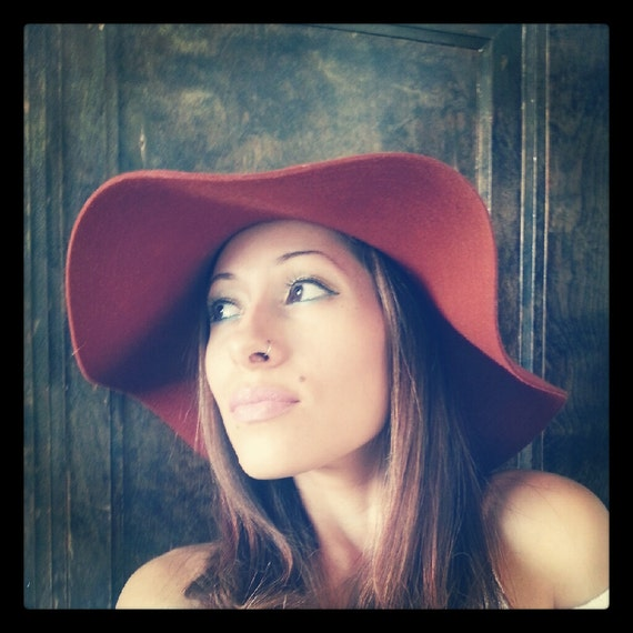Vibrant, ONE OF A KIND, burnt orange floppy hat, adorned with funky fabric, cowrie shell, and feathers