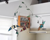 Flying Birds Mobile, multi-colored stained glass birds floating under leaf covered branches - vibrant neon