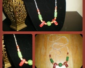 EMPAASTE - ( hand crafted clay beads on a raw hemp knotted cord - burgundy green cream gold natural)