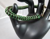 Brown and green aluminum Queen's maille bracelet with gold leaf toggle clasp