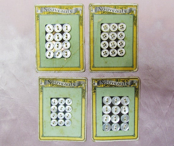 Vintage mother-of-pearl buttons on cards, early 1900's