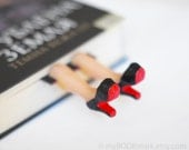 Louboutin shoes. Elegant high fashion gift. Legs in the book. Black and red. Desk accessory.