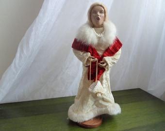 Vintage christmas carolier figure