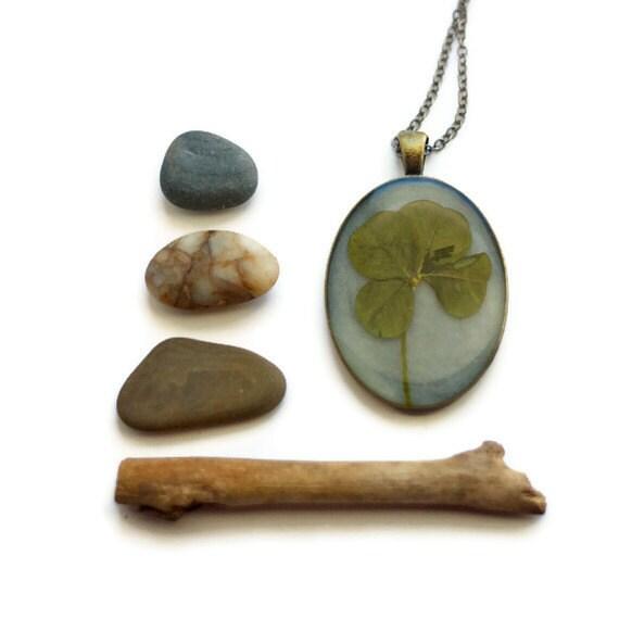 resin jewelry four leaf clover real pressed leaf botanical pendant. sage green 4 leaf clover set in resin get lucky luck saint patricks day