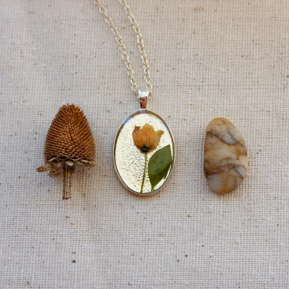 pressed flower necklace. real resin peach wildflower botanical pendent.