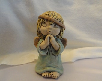 Carol Rardon was a great artist making chalkware pieces from plaster in the 1970s and 1980s.
