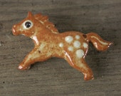 Horse brooch,  rust and white stoneware