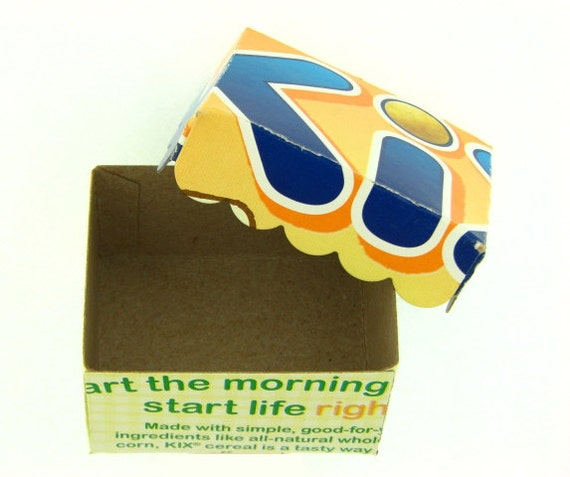 KIX CEREAL gift box with scalloped edge lid made from recycled packaging