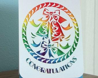 Congratulations card papercut with rainbow swirl