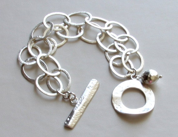 Sterling silver 2-strand chain link bracelet with hammered bead charm and toggle clasp
