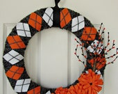 halloween yarn wrapped argyle wreath black gray orange and white with flowers