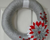 Holiday yarn wrapped wreath with large flower