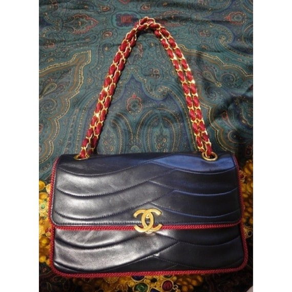 Reserved for Vonessa: 80s rare vintage Chanel navy purse with wine red string and gold chain.  Very rare piece from the era.