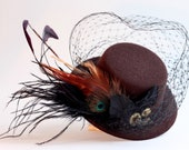 Brown mini top hat fascinator with cogs and feathers inspired by the steam punk movement