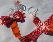 Pink and orange animal print pacifier clip- binky holder- baby needs