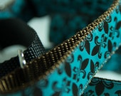 Turquoise and brown fleur de lis on 1 inch martingale or buckle dog collar.
