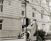 Old Vintage Photo -  Police officer in Uniform next to call box
