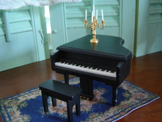 Miniature dollhouse piano and candleabra