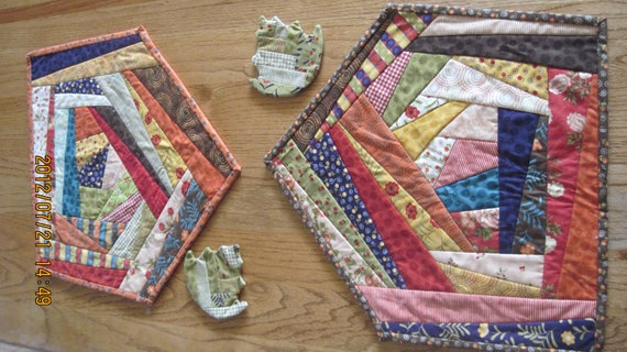 """Colorful """"crazy quilt"""" 5-sided placemats with matching coasters"""