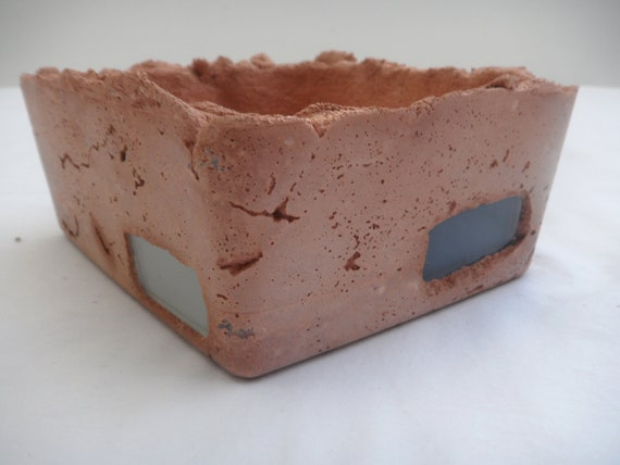 Shallow rustic terracotta tinted cement planter with fun glass tiles