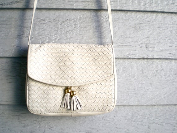 vintage woven leather purse with tassels. over the shoulder bag by Ganson.