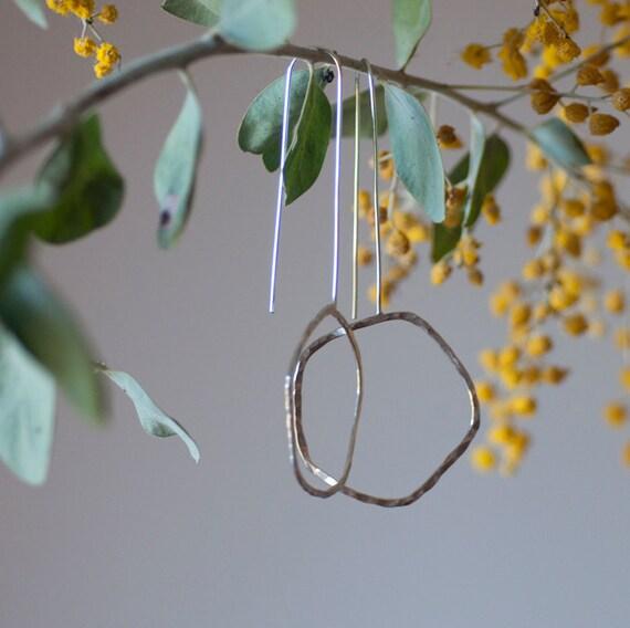 Hoops on a long thread. Sterling silver earrings