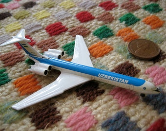 vintage model plane - uzbekistan - blue white green - 60s pan am style