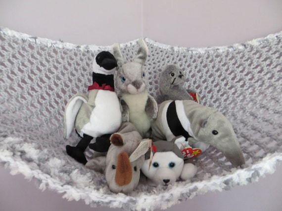 Crochet toy net hammock in gray with gray and white sprinkle