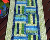 Quilted Table Runner with a Green & Blue Hued Criss-Cross Design