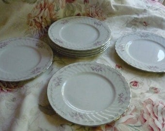 Gold Standard Set of Seven China Luncheon Plates