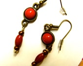 Raspberry red, dangly  Earrings in bronze/brass.