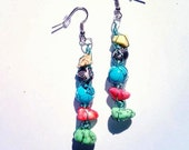 Jade, melon, and light yellow stones with sky blue / black paint splattered bead, and black / white bead wrapped in teal wire