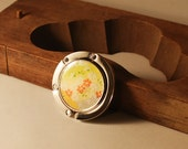 Handbag hook with a yellow japanese paper with flowers