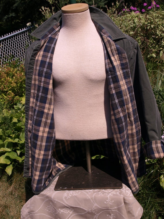 L L Bean ,green,plaid flannel inside.Size L Reg.waiting for a new owner