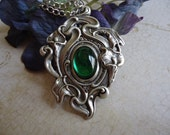 Art Nouveau pendant necklace with a green glass stone