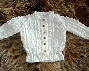 Hand knit cardigan for children with cables and  bobbles