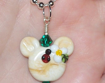 Handmade Cream Colored Lady Bug & Flower Mouse Ears Lampwork Pendant with Swarovski Crystals on a SilverTone Ball Chain