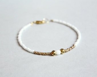 snow - dainty beaded bracelet - white and bronze ethnic modern jewelry