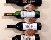 Rusted 4-bottle wine rack