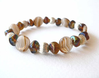 Bracelet in brown handmade with brown and beige glass beads. ooak made in Italy